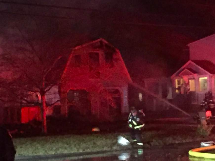 Firefighters responded to a house fire in Cheshire on Tuesday, Nov. 21, 2017. @| Bailey Wright, Record-Journal