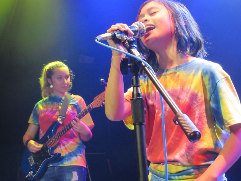 Alex Cardenas, 9, sings in Heiress, backed  by Maya Garlick, 13, on guitar, part of a showcase of Wallingford music instructor Pat Russo's students at Toad