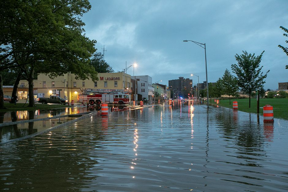 Pratt Street flooded in Meriden, Tuesday, Sept. 25, 2018. Heavy rain Tuesday evening closed roads and flooded basements of local homes. Dave Zajac, Record-Journal