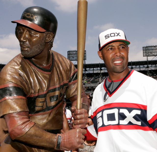 FILE - In this July 20, 2008, file photo, Chicago White Sox first base coach Harold Baines poses with his life-sized sculpture during a ceremony before their baseball game against the Kansas City Royals, in Chicago. Baines will be inducted into the Baseball Hall of Fame on Sunday, July 21, 2019. (AP Photo/Nam Y. Huh, File)