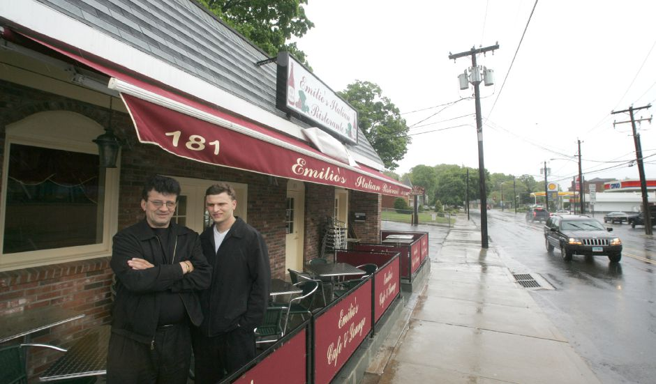 Mario Gutic, left, and his son Emilio Gutic stand in front of their new restaurant Emilio