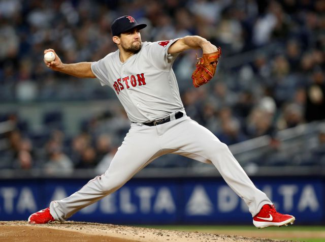 Boston Red Sox starting pitcher Nathan Eovaldi winds up during the fourth inning of a  baseball game against the New York Yankees, Wednesday, April 17, 2019, in New York. (AP Photo/Kathy Willens)