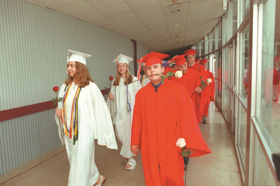 RJ file photo - Cheshire High School seniors carry roses as they proceed down the corridor to the gym for graduation ceremonies June 16, 1998. The graduation was moved indoors because of the threat of thunderstorms.