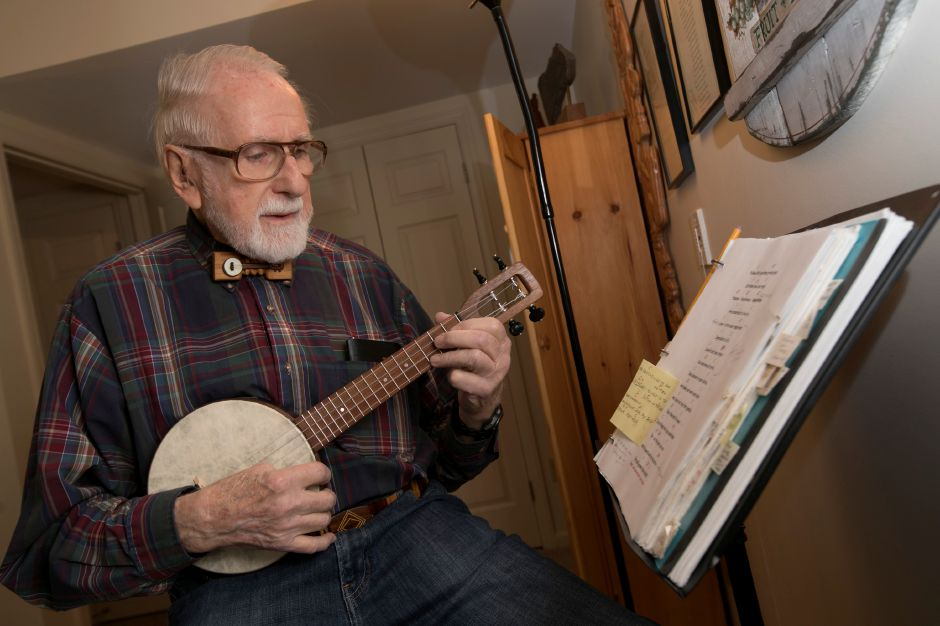 Marv Beloff, of Wallingford, strums away on a banjo ukulele at his residence in Ashlar Village in Wallingford, Thursday, Dec. 14, 2017. Beloff is also an author and founder of the International Wooden Bow Tie Club. Dave Zajac, Record-Journal