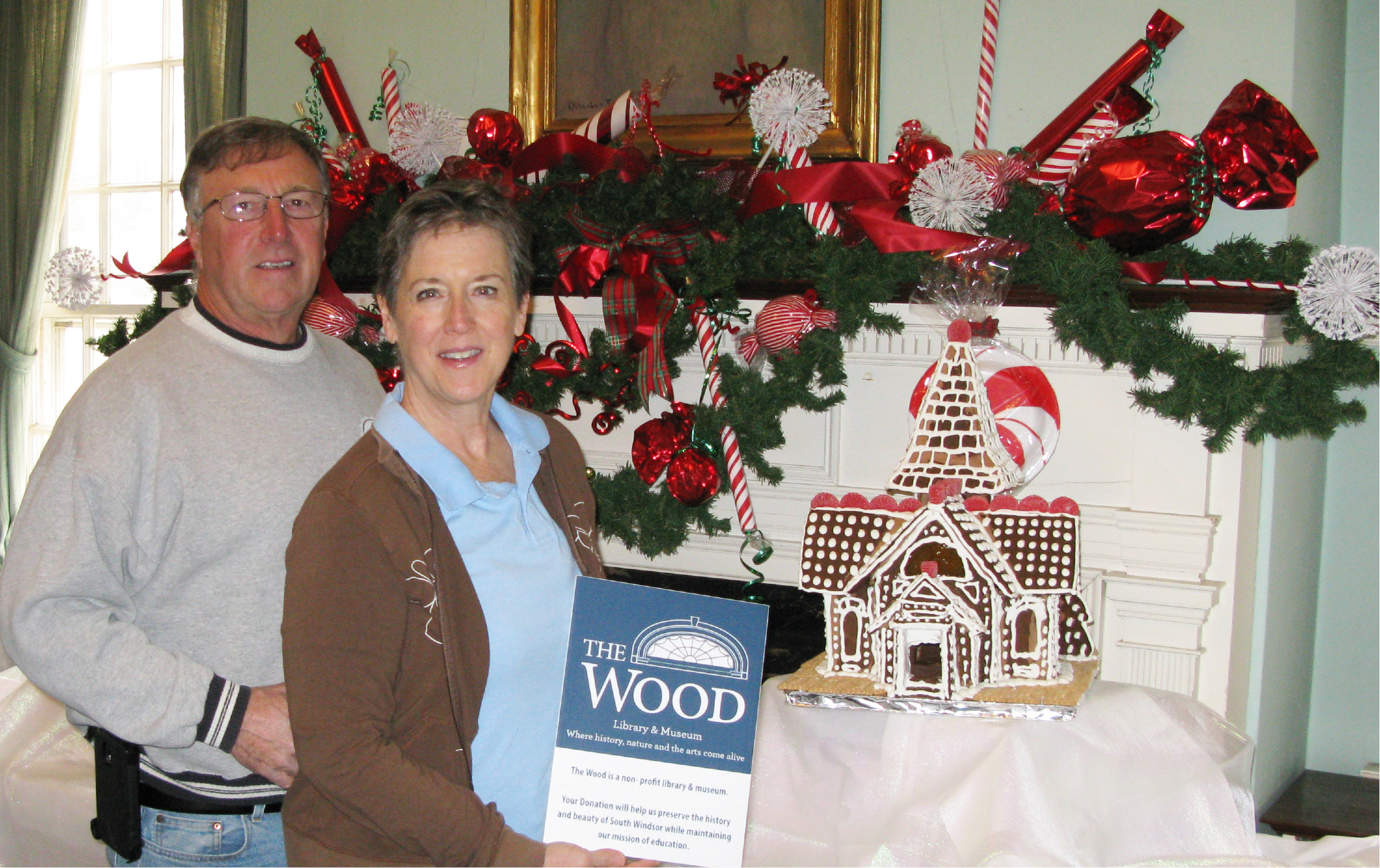 Cheshire residents Dave and Diane Calabro pose with their gingerbread creation, a donation to the Wood Memorial Library's 6th Annual Gingerbread Festival, one of the largest of its kind in New England.