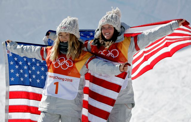 Gold winner Chloe Kim, of the United States, (1) and bronze winner Arielle Gold, of the United States, celebrate after the women