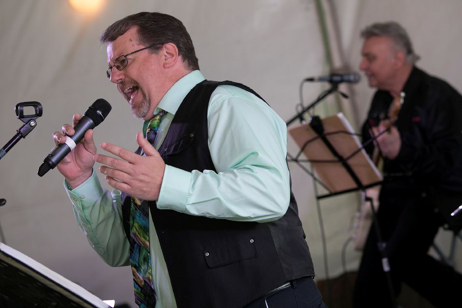 Tom Burbank, of Southington, lead vocalist of the band Sharades, performs for the sponsors and volunteers appreciation dinner as part of the 40th annual Daffodil Festival at Hubbard Park in Meriden, Thursday, April 26, 2018. Dave Zajac, Record-Journal