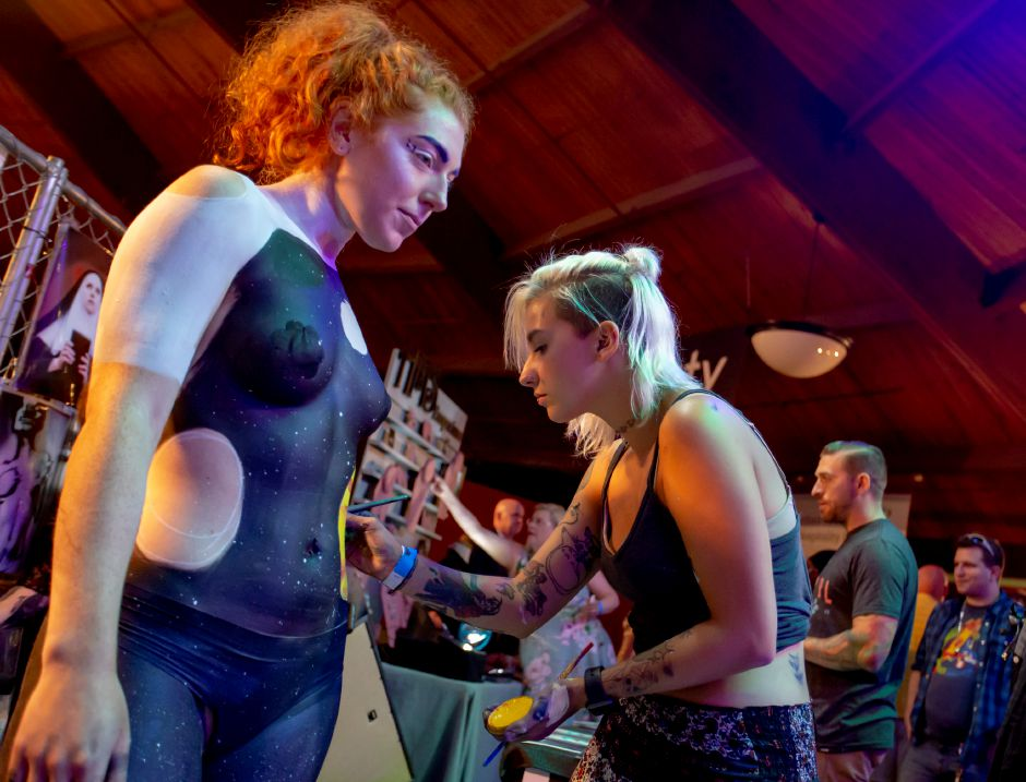 Carlee Carvalko, a makeup artist and body painter, shows off her work during the RAW Artist Connect showcase at the Oakdale Theatre in Wallingford July 18, 2018. | Richie Rathsack, Record-Journal