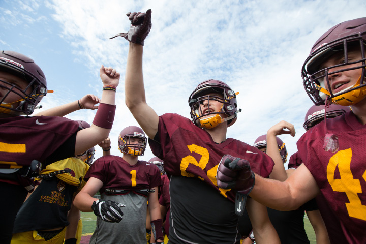 Senior captain Evan Mansfield (24) gets the Sheehan football team fired up for a scrimmage at Riccitelli Field in Wallingford. Mansfield, a third-year starter at safety and receiver, is one of just three starting seniors for the Titans this fall. | Justin Weekes, Special to the Record-Journal