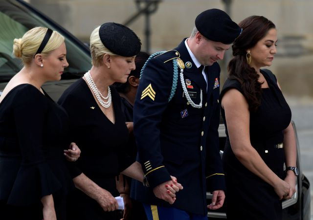 From left, Meghan McCain, Cindy McCain, Jimmy McCain and his wife Holly pause as they watch the casket of Sen. John McCain, R-Ariz., arrive at the Washington National Cathedral in Washington, Saturday, Sept. 1, 2018, for a memorial service. McCain died Aug. 25 from brain cancer at age 81. (AP Photo/Susan Walsh)