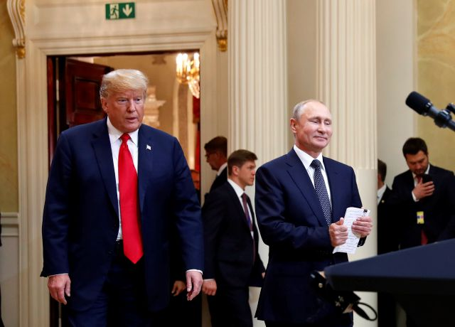 In this July 16, 20198, photo, U.S. President Donald Trump, left, and Russian President Vladimir Putin arrive for a news conference at the Presidential Palace in Helsinki, Finland. Trump has asked national security adviser John Bolton to invite Putin to Washington in the fall. That