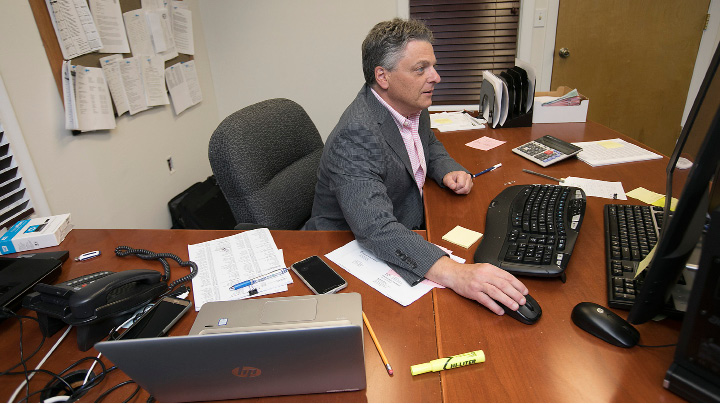 Dominic Barone, the new business manager for the Wallingford Board of Education, works at his desk, Friday, July 14, 2017.   | Dave Zajac, Record-Journal