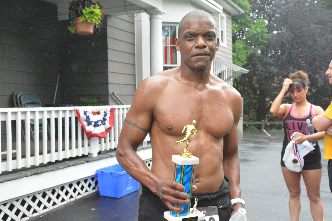 Second place winner Phillip Crowsby posing with his Meriden Memorial Mile trophy. | Ariana D