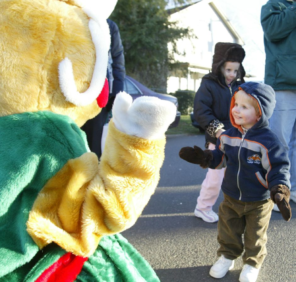 Robbie Whitehead, 18 months, from Oxford, Conn. meets the gingerbread lady in South Meriden at Christmas in the Village on Dec. 3, 2005.