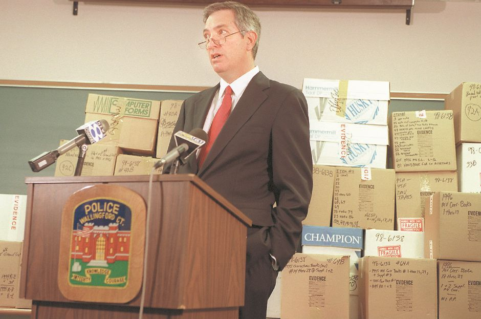 RJ file photo - Wallingford Police Chief Douglas Dortenzio talks about the tax-office investigation during a press conference at police headquarters Aug. 14, 1998. Five people, including Town Assessor and Appraiser, were charged with varying degrees of larceny.