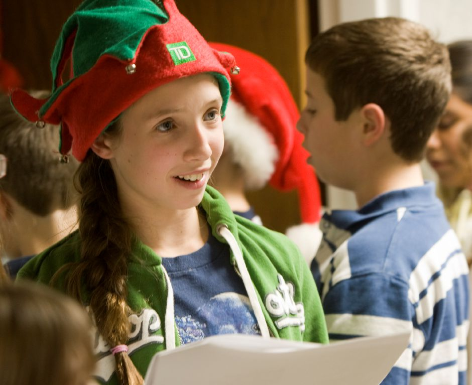 Pond Hill school student Michaela Furman, 10, sings Christmas carols to seniors at Masonicare Health Center in Wallingford December 21, 2010. (Dave Zajac/Record-Journal)