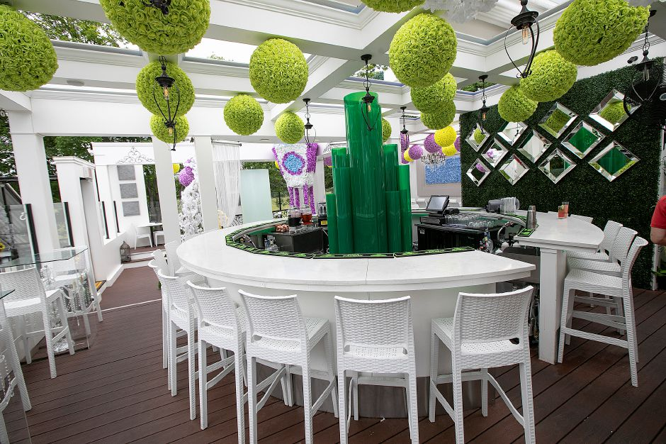 "The rooftop bar transformed into the Emerald City as part of Cava Restaurant's ""The Wizard of Oz""-themed dining in Southington."