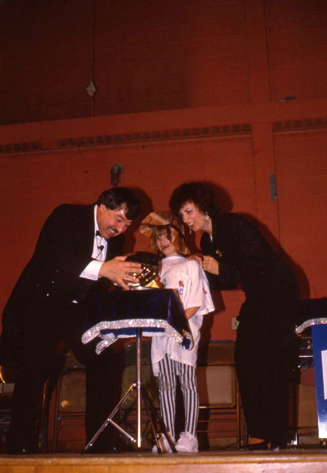 RJ file photo - The Great Leone gets help from Charlotte Timour, 6, and from his assistant. The magic show was sponsored by the Wallingford Recreation Department, Feb. 1994.