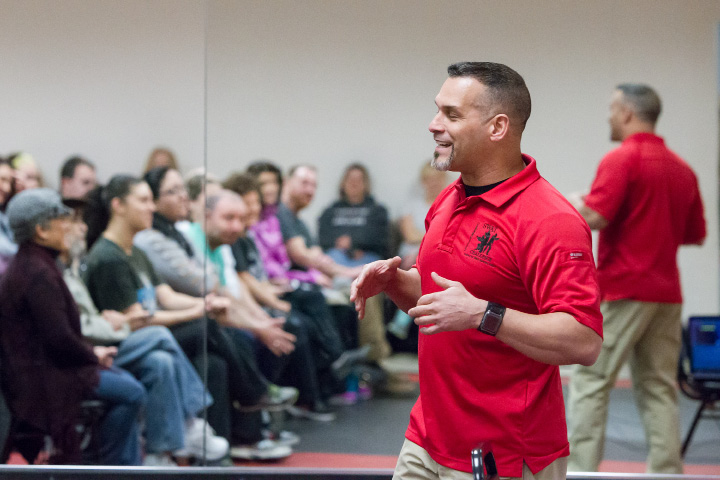 Meriden Police Officer Daniel Cruz talks about self defense and the law in his presentation Saturday during a self defense seminar at Baran's Kenpo Karate in Wallingford Mar. 4, 2017 | Justin Weekes / For the Record-Journal