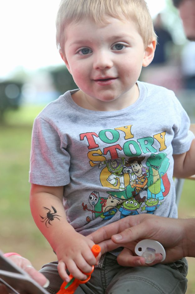 SJ Passmore, 2, of Meriden, smiles as he shows off the spider painted on his arm during the celebration of the American Legion's 100th anniversary at the annual American Legion Post 45 All American Picnic in Meriden on Saturday, Sept. 14, 2019. Emily J. Tilley, special to the Record-Journal.