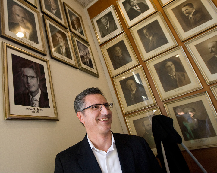 Former Meriden mayor Manny Santos smiles next to his portrait added to the wall of mayors at City Hall, Thursday, October 20, 2016.   | Dave Zajac, Record-Journal