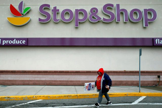 FILE - In this Thursday, April 18, 2019, file photo, a striking worker walks outside a Stop & Shop supermarket in Revere, Mass. Stop & Shop supermarket workers and company officials said Sunday, April 21 they