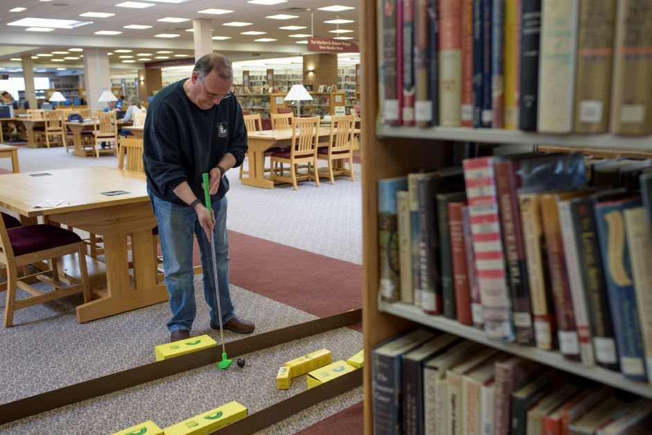 Wallingford resident Thirl Gravell plays the course. The Wallingford Public Library set up a mini-golf course on Saturday for ages 5+. Proceeds would benefit the library. Monica Jorge/Special to the Record-Journal