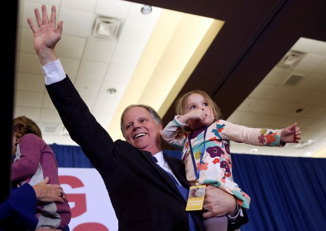 Doug Jones waves to supporters before speaking during an election-night watch party Tuesday, Dec. 12, 2017, in Birmingham, Ala. Jones won election to the U.S. Senate from Alabama, dealing a political blow to President Donald Trump. (AP Photo/John Bazemore)