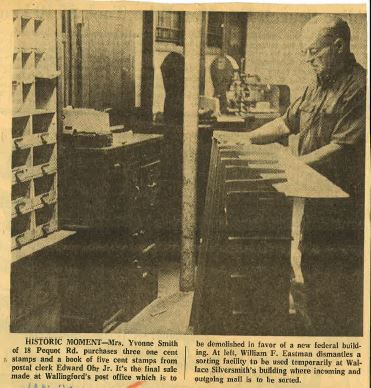 William F. Eastman dismantles a sorting facility to be used temporarily at Wallace Silversmith's building where incoming and outgoing mail is to be sorted. | AdwinRusczek, Record-Journal