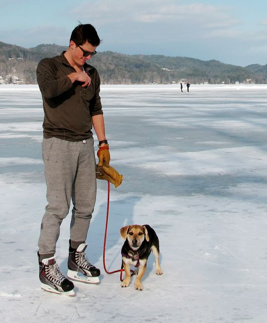 In this Jan. 20, 2018 photo, Jeph Shaw, of Hanover, N.H., skates with his dog on Lake Morey, in Fairlee, Vt., which has a 4.5-mile Nordic ice skating trail, said to be the longest in the United States. (AP Photo/Lisa Rathke)