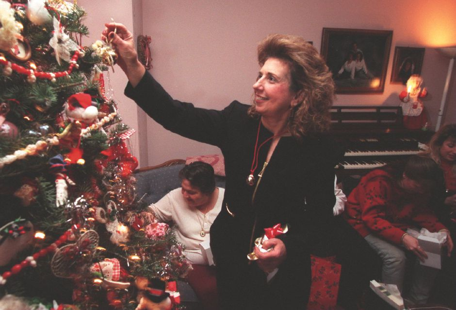 RJ file photo - Jean Little hangs a new ornament on the tree, Dec. 1998.