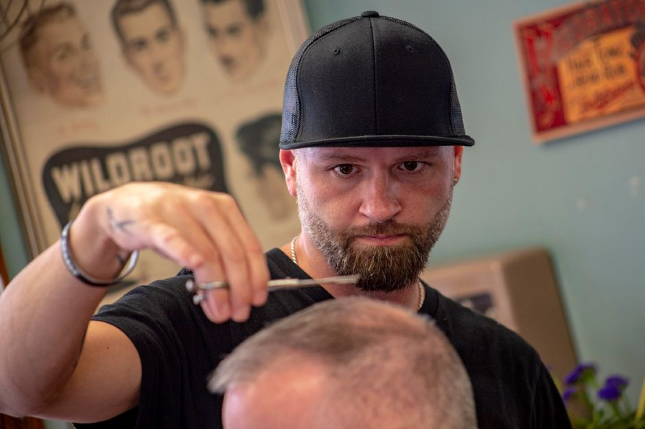 Edward Pratt takes a little off the top of Larry Jardin at the Village Barber Shop in South Meriden Sept. 19, 2018. | Richie Rathsack, Record-Journal