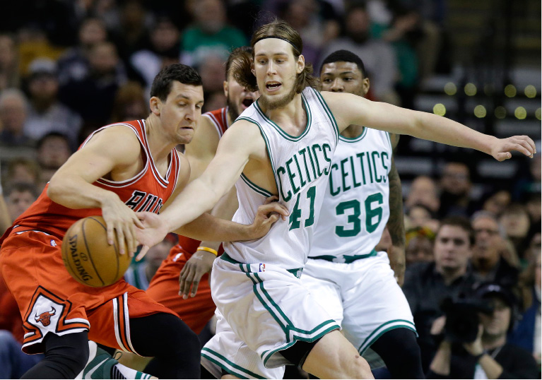 Chicago Bulls forward Paul Zipser, of Germany (16), left, and Boston Celtics center Kelly Olynyk, center, vie for control of the ball in the first quarter of an NBA basketball game, Sunday, March 12, 2017, in Boston. (AP Photo/Steven Senne)