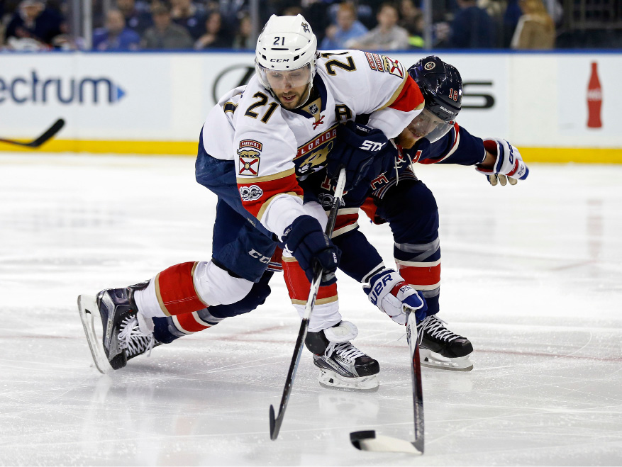 Florida Panthers center Vincent Trocheck (21) battles for the puck with New York Rangers defenseman Marc Staal (18) during the first period of an NHL hockey game, Friday, March 17, 2017, in New York. (AP Photo/Adam Hunger)