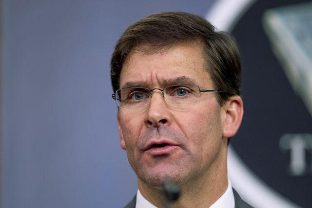 "FILE - In this Aug. 28, 2019, file photo, Secretary of Defense Mark Esper speaks to reporters during a briefing at the Pentagon. Esper says the ""impulsive"" decision by Turkey to invade northern Syria will further destabilize a region already caught up in civil war. Esper says the invasion puts America"
