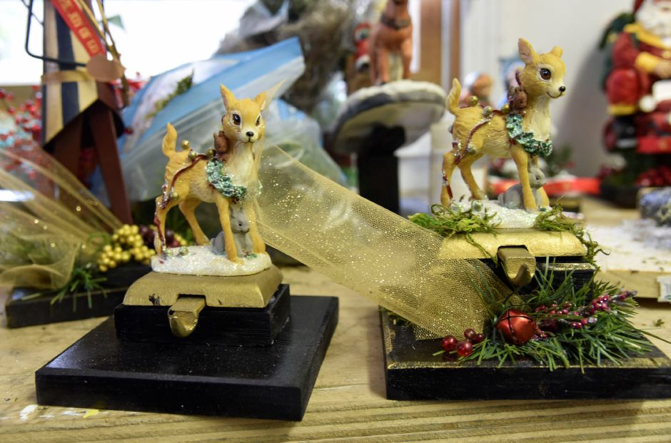 The annual Go Far Jingle All the Way 5K, which is on Dec. 16, will features almost 100 homemade and completely unique trophies, made by the founder of Go Far. | Bailey Wright, Record-Journal