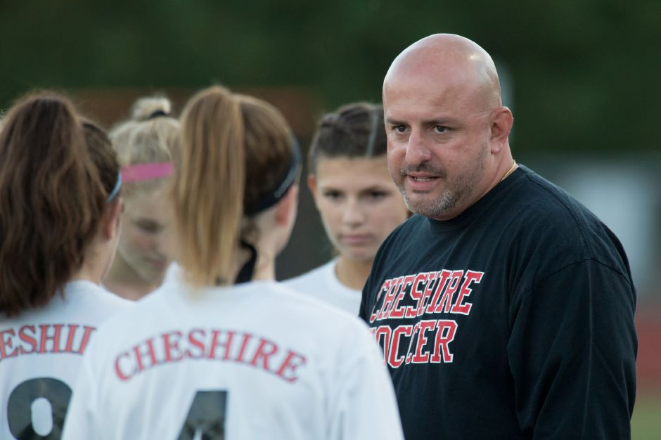 James Luis talks with his players during a 2017 game. Luis stepped down Thursday after spending 12 total seasons with Cheshire High School girls soccer, including the last six as head coach.| Justin Weekes / For the Record-Journal