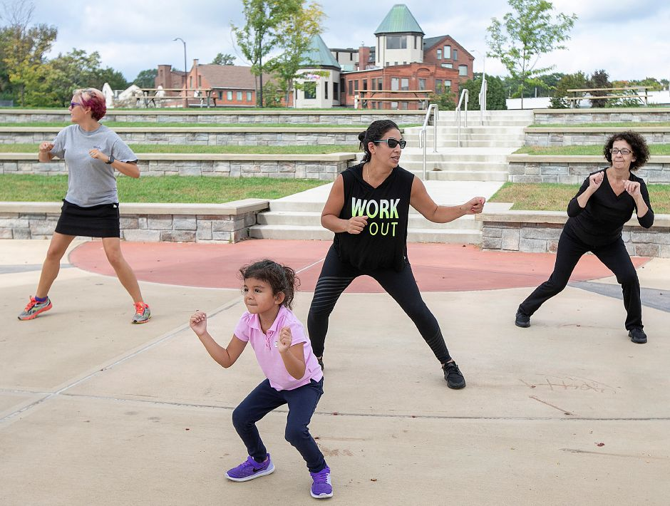 "From left, Kathy Matula, recreation coordinator, Laura Marquet and daughter, Bianca, 4, of Meriden, and Mariel Chalaman, of Meriden, work out during the Meriden Parks and Recreation's ""Get Going on the Green"" program. Photos by Dave Zajac, Record-Journal"