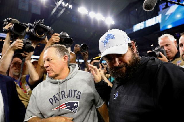 New England Patriots head coach Bill Belichick, left, and Detroit Lions head coach Matt Patricia meet after their teams