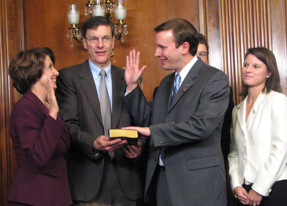Newly elected Speaker of the House Nancy Pelosi, is swearing in Chris Murphy, the democratic congressman-elect from Connecticut, in at the U.S. Capitol in Washington Thursday, January 4, 2007. In the middle holding the bible is his father Scott L. Murphy. On the right is his fiance Cathy Holahan.
