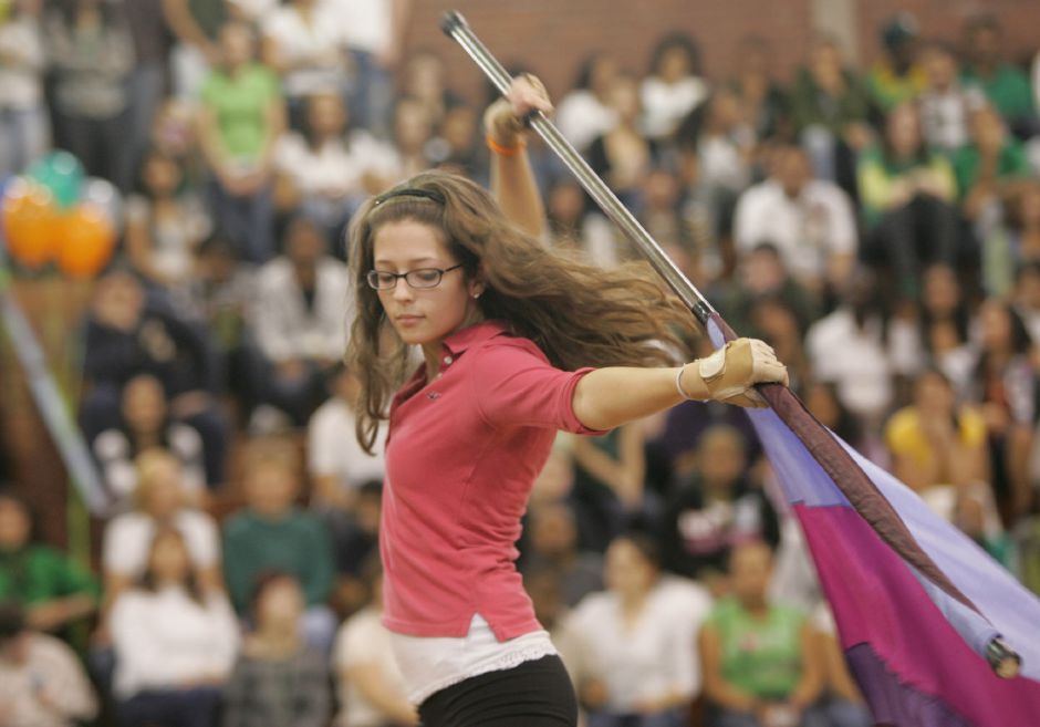 Kaitlyn (cq) Garbe (cq), 16, performs with the winter guard during pep rally 2009 at Maloney High School November 25, 2009. (dave zajac photo)