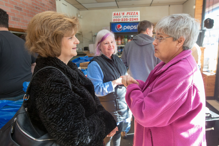 Volunteers Sue Richards left Jan Levine and Karen Lavine all of Meriden talks before delivering meals Sunday during the Meriden YMCA