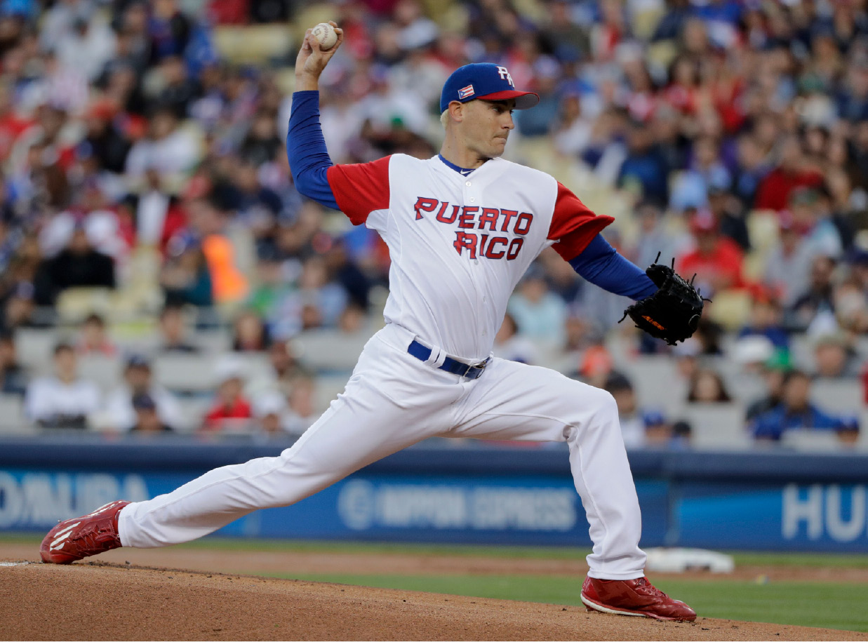 Puerto Rico pitcher Seth Lugo throws against the United States during the first inning of the final in the World Baseball Classic in Los Angeles, Wednesday, March 22, 2017. (AP Photo/Jae C. Hong)
