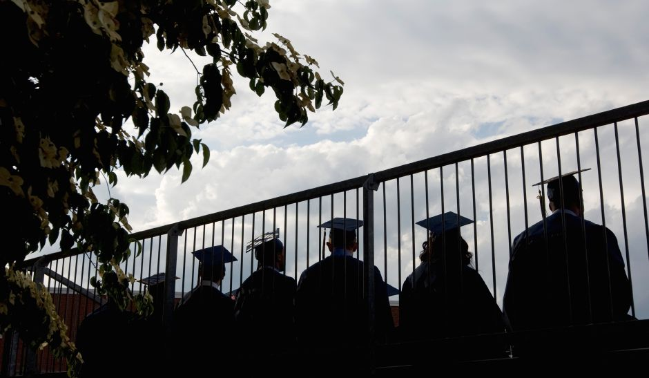 Members of the class of 2015 look on from the top row of the bleechers during graduation ceremonies at Platt High School in Meriden, Friday, June 19, 2015. | Dave Zajac / Record-Journal