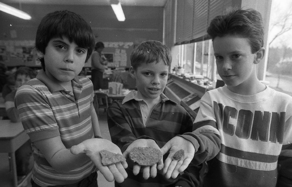 RJ file photo - Moses Y. Beach third-graders Nicholas LaPointe, Jeffrey Sanderson and David Donahue, all 9, discovered a sandstone filled with fossils on the school