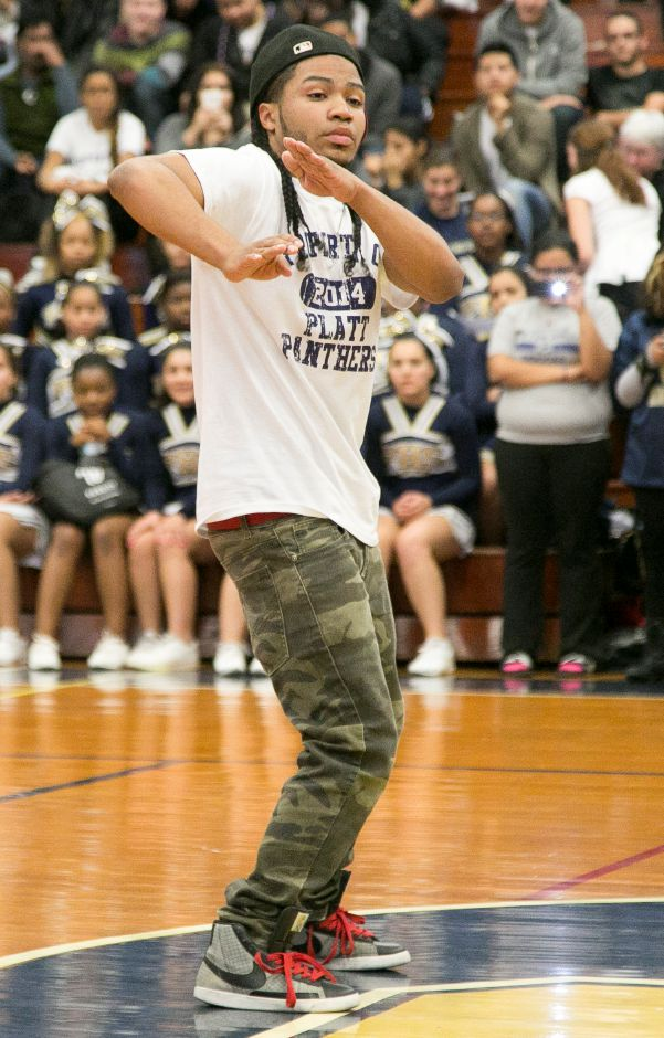Elijah Castillo showcases his dance moves during the pep rally at Platt High School in Meriden, Nov. 27, 2013. | Christopher Zajac / Record-Journal