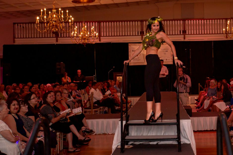 "Angela Darmanin lights up the runway with ""The Nest Bra"" during the Art Bra 2018 Runway Show and Auction Aug. 9, 2018 at the Aqua Turf in Southington. 