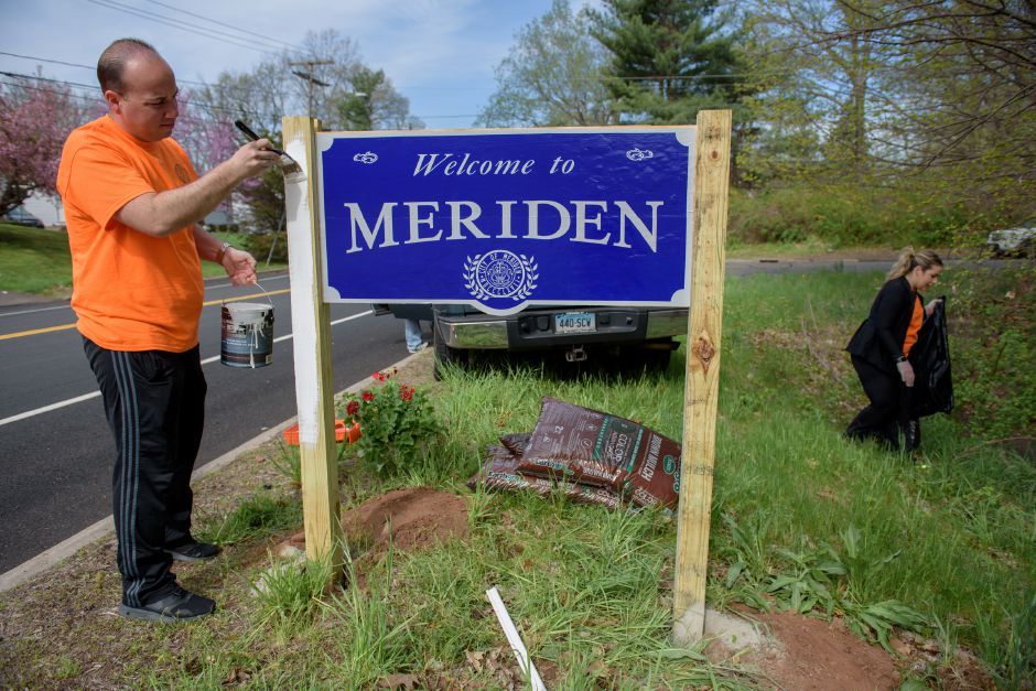 MERIDIAN, CONNECTICUT - 05/05/2018: Mayor Scarpati paints a new welcome sign on Preston Avenue. Meriden Mayor Scarpati and the Council of Neighborhoods put on their annual Mayor