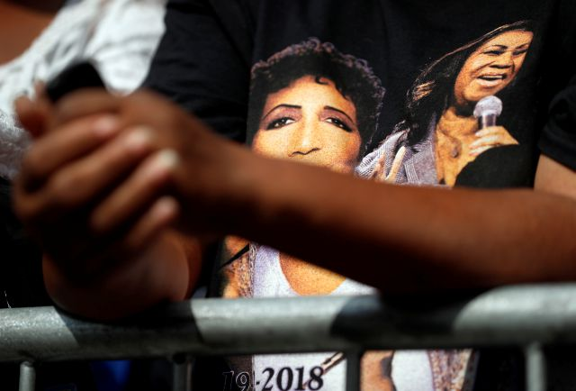 Pearl Hays stands behind a barrier outside New Bethel Baptist Church as a viewing for Aretha Franklin is held inside on Thursday, Aug. 30, 2018, in Detroit. Franklin died Aug. 16, 2018 of pancreatic cancer at the age of 76. (AP Photo/Jeff Roberson)