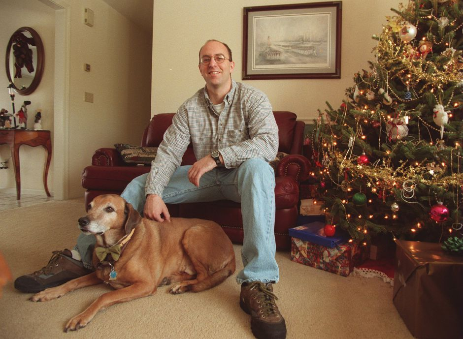 RJ file photo - Matthew Florczyk, a Ph.D. candidate at the University of Albany, sits with his dog, Apollo, in his parents